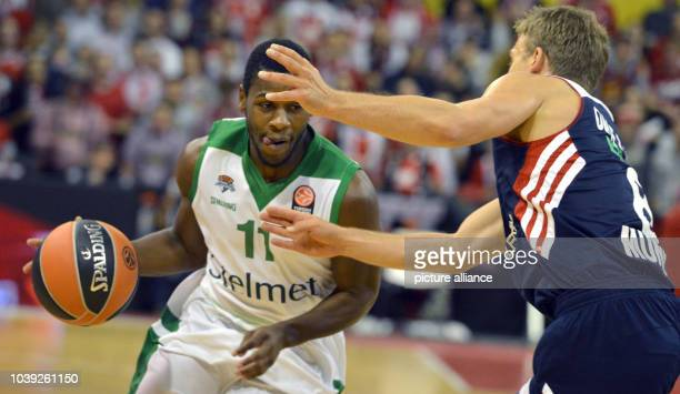 Munich's Heiko Schaffartzik  vies for the ball with Zielona Gora's Erving Walker during the basketball Euroleague men't group C match between Bayern...