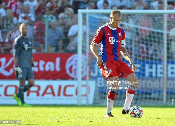 Munich's Holger Badstuber vies for the ball during the tryout match between FC Bayern Munich and an Allgau selection in Memmingen Germany 18 July...