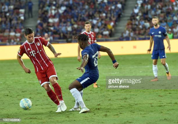 Munich's James Rodriguez and Chelsea's Michy Batshuayi vie for the ball during the International Champions Cup friendly soccer match between FC...