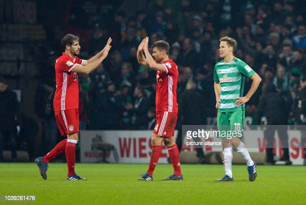 Munich's Javi Martinez and Xabi Alonso celebrate their victory next to Bremen's Niklas Moisander uring the German Bundesliga soccer match between...