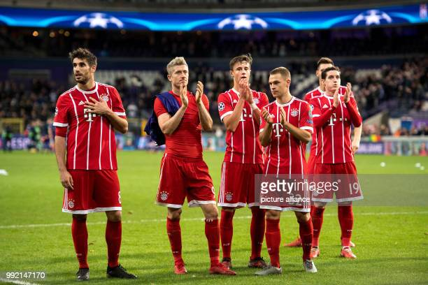 Munich's Javi Martinez Robert Lewandowski Marco Friedl Joshua Kimmich and Sebastian Rudy giving thanks to the fans after the Champions League soccer...