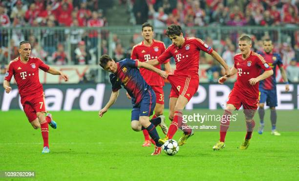 Munich's Javier Martinez and Barcelona's Lionel Messi vie for the ball during the UEFA Champions League semi final first leg soccer match between FC...
