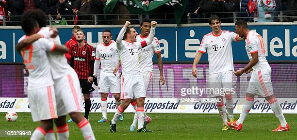 Munich's Jerome Boateng celebartes with teammates after the 10 victory after the German first division Bundesliga football match between Eintracht...