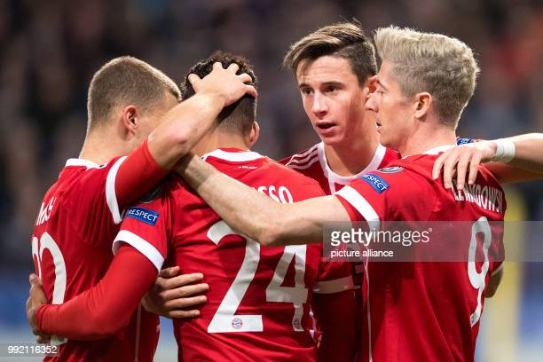 Munich's Joshua Kimmich Corentin Tolisso Marco Friedl and Robert Lewandowski celebrating after Lewandowski's scoring of the 10 lead during the...