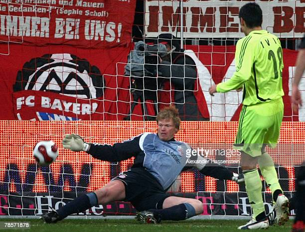 Munichs keeper Oliver Kahn safes a shot during the UEFA Cup Group F match between Bayern Munich and Aris Saloniki at the Allianz Arena on December 19...