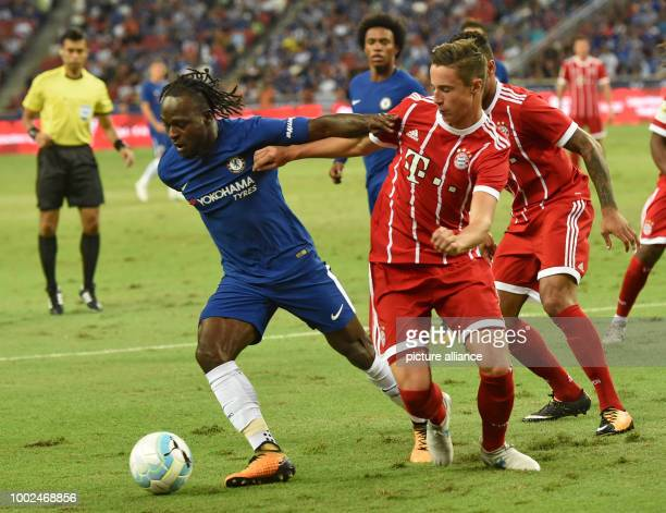 Munich's Marco Friedl and Chelsea's Michy Batshuayi vie for the ball during the International Champions Cup friendly soccer match between FC Bayern...