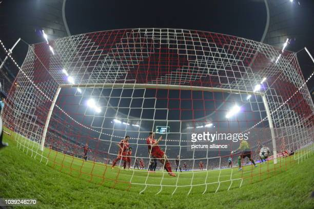 Munich's Mario Gomez scores the 20 goal as his team mate Javi Martines and Barcelona's Victor Valdes looks on during the UEFA Champions League semi...