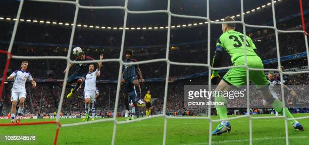 Munich's Mario Mandzukic scores the 20 against Moscow's Igor Akinfeev during the UEFA Champions League Group D soccer match between FC Bayern Munich...