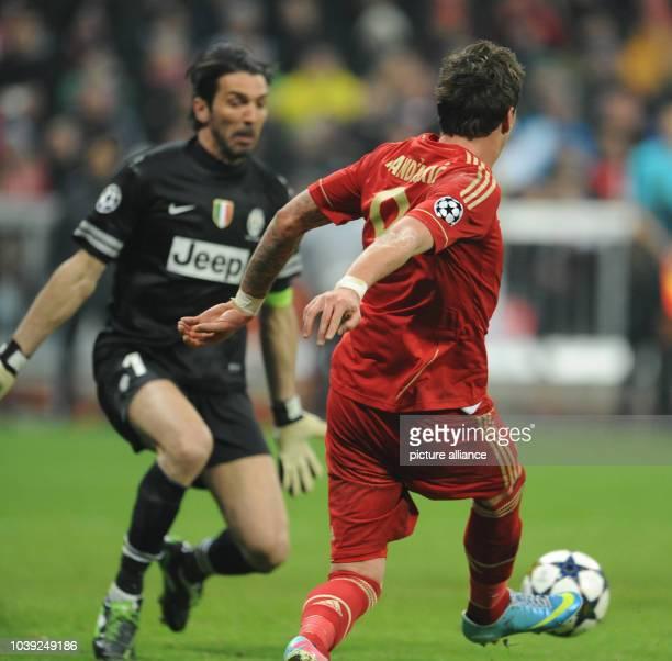 Munich's Mario Mandzukic tries to score against Turin's goalkeeper Gianluigi Buffon during the UEFA Champions League quarter final first leg soccer...