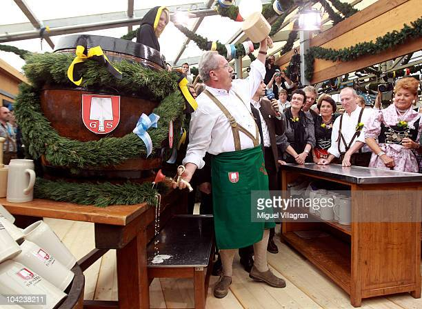 Munich's mayor Christian Ude opens the Oktoberfest after opening the first beer barrel to start the Oktoberfest beer festival at the Schottenhamel...
