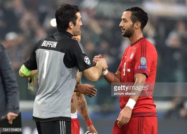 Munich's Medhi Benatia talks to Juve's Gianluigi Buffon after the UEFA Champions League round of 16 first leg soccer match between Juventus Turin and...