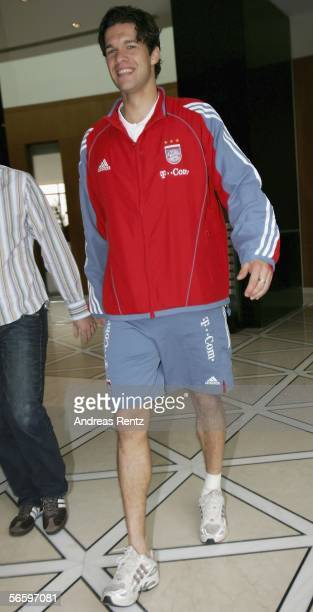 Munich's Michael Ballack who injured his left ankle in the morning training session walks in the lobby of the Emirates Tower Hotel as the team...