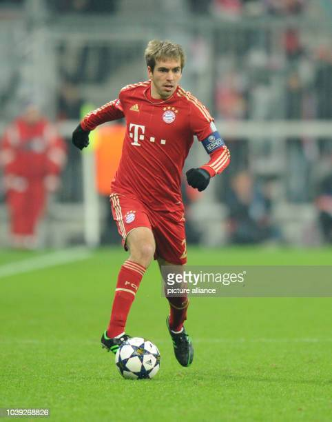 Munich's Philipp Lahm in action during the UEFA Champions League soccer round of sixteen between FC Bayern Munich and Arsenal FC at Fußball Arena...