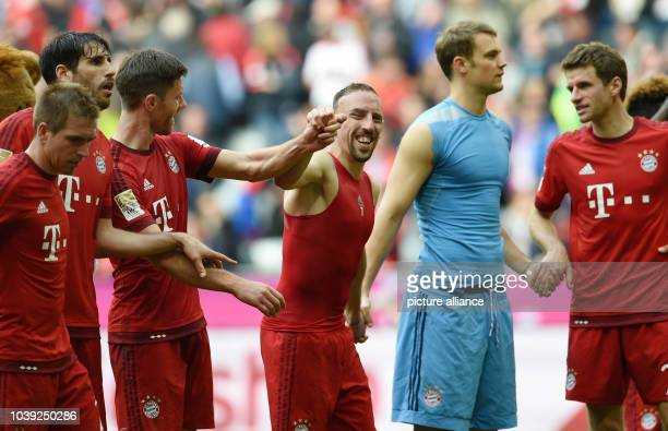 Munich's Philipp Lahm Javier Martinez Xabi Alonso Franck Ribery goalkeeper Manuel Neuer and Thomas Mueller say goodbye to fans after the German...