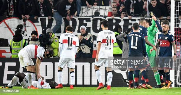 Munich's players celebrate after goalkeeper Sven Ulreich saved a penalty shot by Stuttgart's Congolese forward Chadrac Akolo in the last minute of...