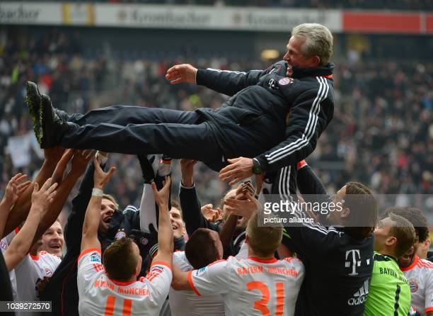 Munich's players throw their head coach Jupp Heynckes into the air in celebration after the Bundesliga soccer between Eintracht Frankfurt and Bayern...