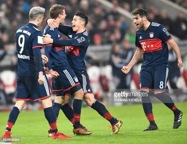 Munich's Polish forward Robert Lewandowski Bayern Munich's German forward Thomas Mueller Bayern Munich's Colombian midfielder James Rodriguez and...
