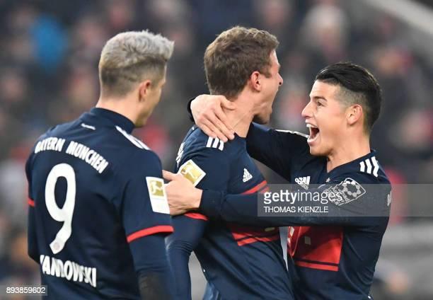 Munich's Polish forward Robert Lewandowski Bayern Munich's German forward Thomas Mueller and Bayern Munich's Colombian midfielder James Rodriguez...