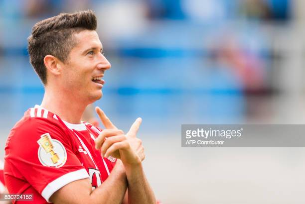 Munich's Polish forward Robert Lewandowski celebrates after scoring the third goal during the German football Cup DFB Pokal first round match between...
