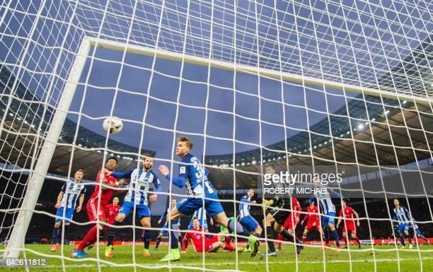 Munich´s Polish forward Robert Lewandowski scores during the German First division Bundesliga football match Hertha Berlin vs Bayern Munich in Berlin...