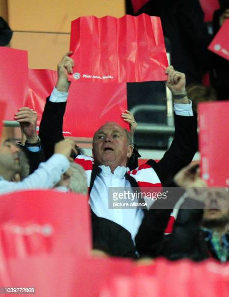 Munich's president Uli Hoeness holds a red sign reading 'mia san mia' prior to the UEFA Champions League semi final first leg soccer match between FC...