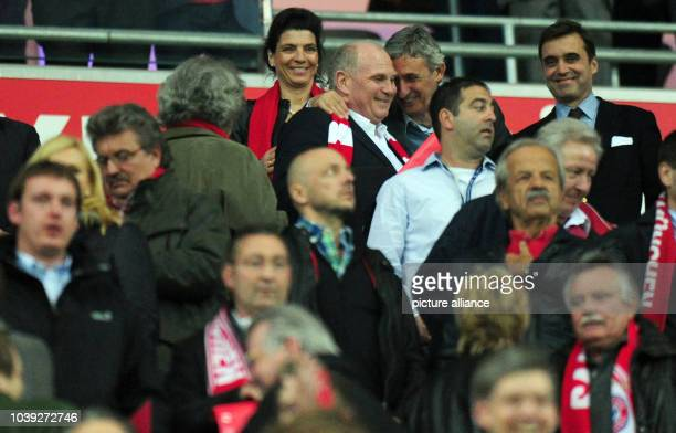 Munich's president Uli Hoeness is hugged by Bayern Munich's basketball coach Svetislav Pesic on the stands prior to the UEFA Champions League semi...