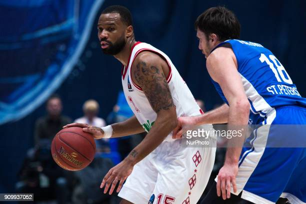 Munich's Reggie Redding and Zenit's Evgeny Voronov vies for the ball during the EuroCup Round 4 Top 16 basketball match between Zenit and Bayern...