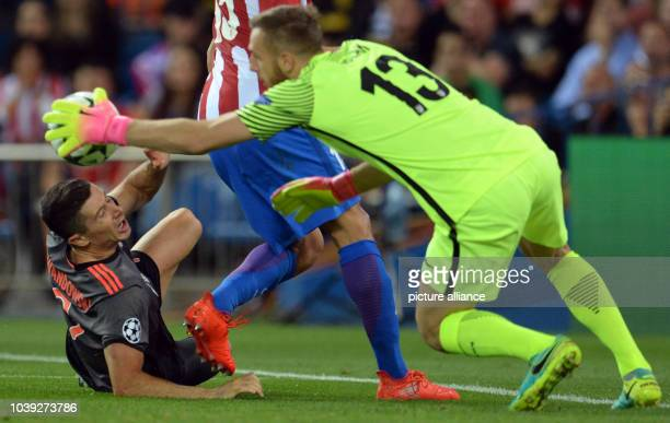 Munich's Robert Lewandowski in action against Madrid's goalkeeper Jan Oblak during the Champions League Group D soccer match between Atletico Madrid...