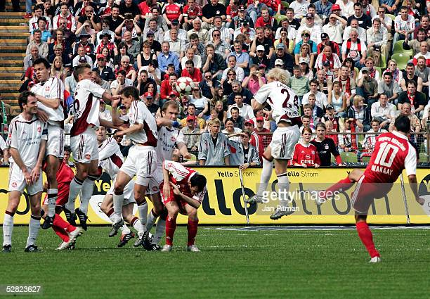 Munich's Roy Makaay scores with a free kick during the Bundesliga match between FC Bayern Munich and 1 FC Nuremberg at the Olympic Stadium on May 14...