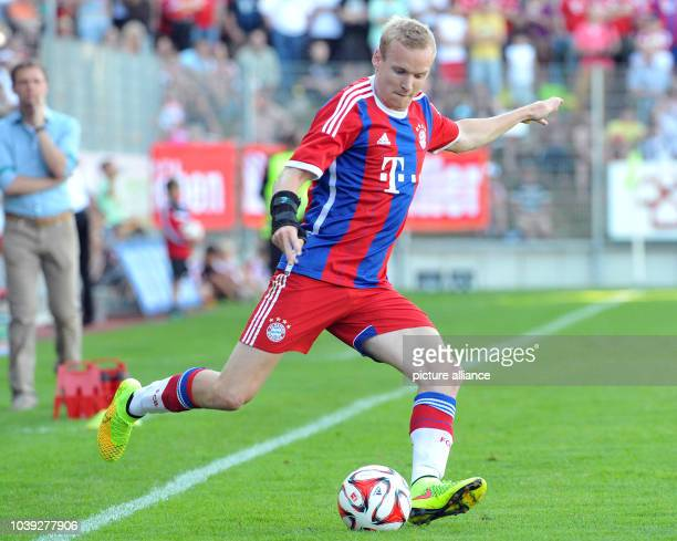 Munich's Sebastian Rode vies for the ball during the tryout match between FC Bayern Munich and an Allgau selection in Memmingen Germany 18 July 2014...
