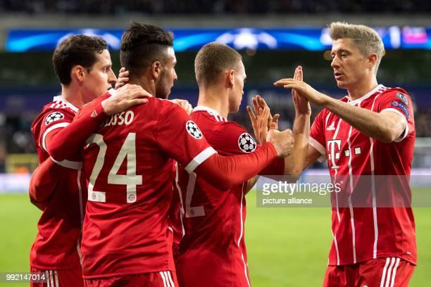Munich's Sebastian Rudy Corentin Tolisso Joshua Kimmich and Robert Lewandowski celebrating after Tolisso's scoring of the 21 lead during the...