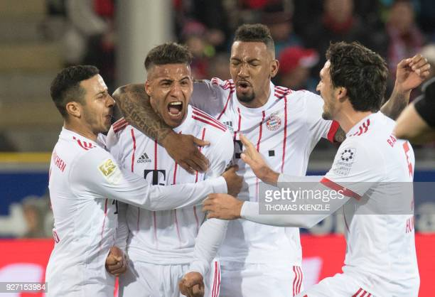 Munich's Spanish midfielder Thiago French midfielder Corentin Tolisso defender Jerome Boateng and defender Mats Hummels celebrate after Tolisso...