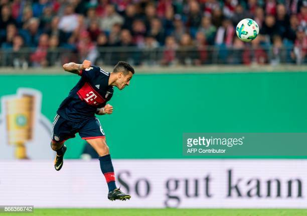 Munich´s Spanish midfielder Thiago scores the 11 during the German Cup football match RB Leipzig v FC Bayern Munich in Leipzig eastern Germany on...