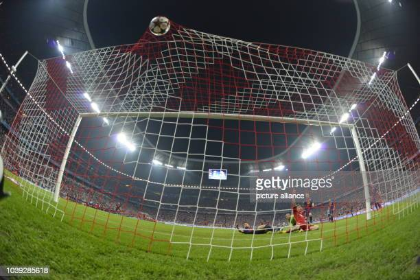 Munich's Thomas Müller jubilates after he scores the 40 during the UEFA Champions League semi final first leg soccer match between FC Bayern Munich...