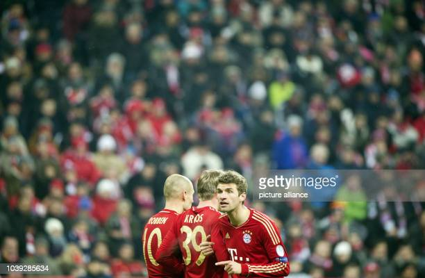 Munich's Thomas Müller Toni Kroos and Munich's Arjen Robben react after the 02 during the Champions League round of 16 second leg soccer match...