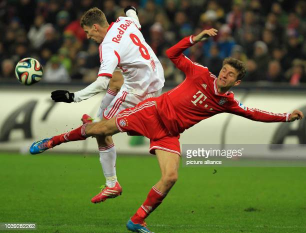 Munich's Thomas Mueller and Salzburg's Florian Klein during the tryout between Red Bull Salzburg and FC Bayern Munich in the Red Bull Arena in...