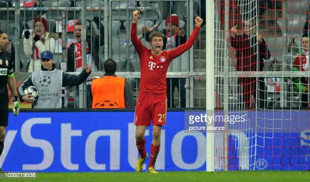Munich's Thomas Mueller celebrates after scoring 20 next to Juventus' goalkeeper Gianluigi Buffon during the UEFA Champions League quarter final...
