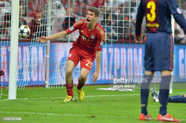 Munich's Thomas Mueller celebrates after scoring the opening goal during the UEFA Champions League semi final first leg soccer match between FC...