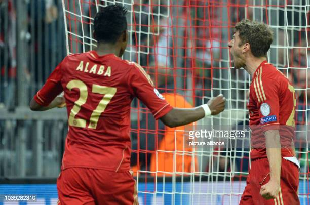 Munich's Thomas Mueller celebrates with David Alaba after scoring the opening goal during the UEFA Champions League semi final first leg soccer match...