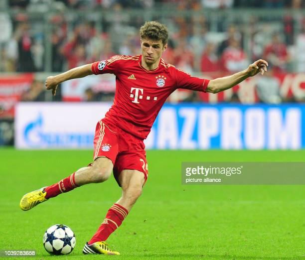 Munich's Thomas Mueller controls the ball during the UEFA Champions League semi final first leg soccer match between FC Bayern Munich and FC...