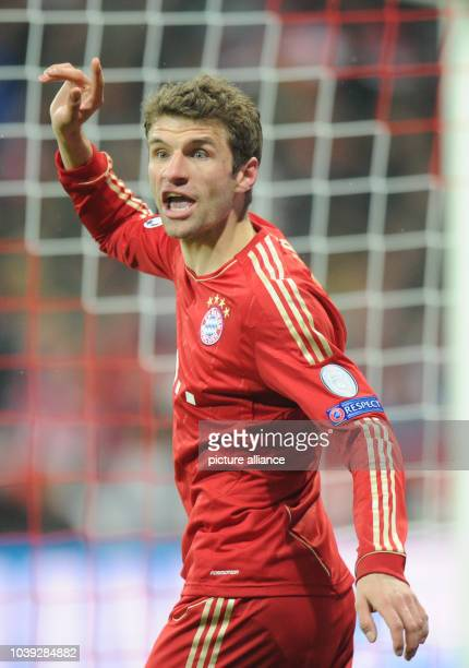 Munich's Thomas Mueller gestures during the UEFA Champions League soccer round of sixteen between FC Bayern Munich and Arsenal FC at Fußball Arena...