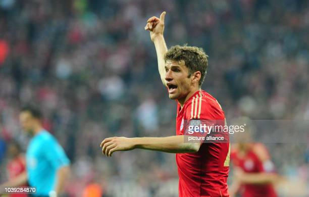 Munich's Thomas Mueller gestures during the UEFA Champions League semi final first leg soccer match between FC Bayern Munich and FC Barcelona at...