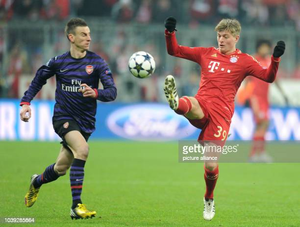 Munich's Toni Kroos and Arsenal's Laurent Koscielny vie for the ball during the UEFA Champions League soccer round of sixteen between FC Bayern...