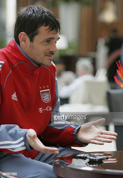 Munich's Willy Sagnol gestures during an interview in the lobby of the Emirates Tower Hotel as the team prepares for the friendly match between...