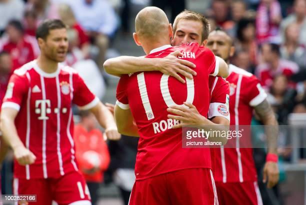 Munich's Xabi Alonso Arjen Robben Philipp Lahm and Arturo Vidal during the German Bundesliga soccer match between Bayern Munich and SC Freiburg in...