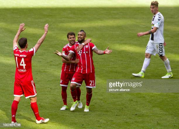 Munich's Xabi Alonso Juan Bernat and Arturo Vidal celebrate after the team takes a 20 lead during the German Bundesliga soccer match between Bayern...