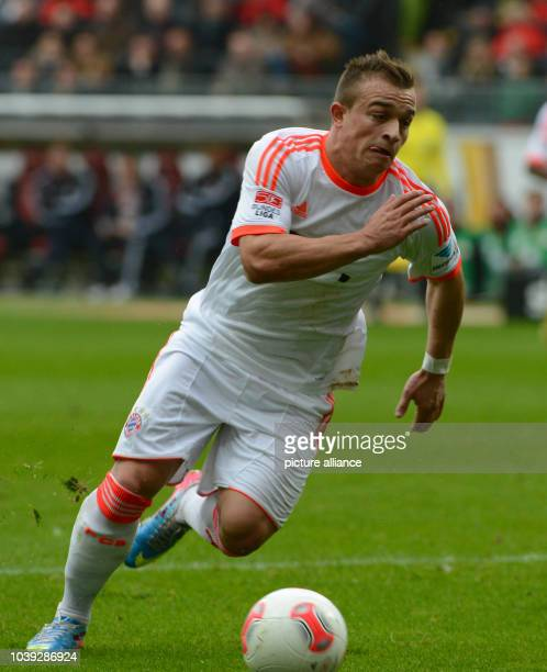 Munich's Xherdan Shaqiri plays the ball during the Bundesliga soccer between Eintracht Frankfurt and Bayern Munich at Commerzbank Arena in Frankfurt...