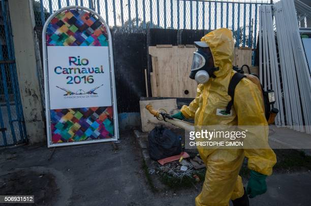 TOPSHOT A municipal agent sprays anti Zika mosquitos chimical product at the sambadrome in Rio de Janeiro on January 26 2016 Brazil is mobilizing...