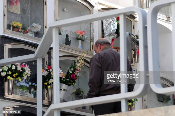 HOSPITALET BARCELONA SPAIN Municipal Cemetery of L'Hospitalet City where a man visits the grave of a deceased relative Spain celebrates the day of...