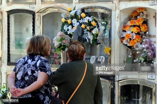 HOSPITALET BARCELONA SPAIN Municipal Cemetery of L'Hospitalet City where two women visit the grave of a deceased family member Spain celebrates the...